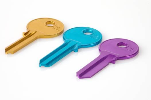Three Keys in a White Background Photo Free Photo
