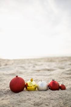 Christmas baubles arranged on the sand #414481