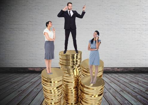 Composite image of businesspeople standing on stacked coins #414509