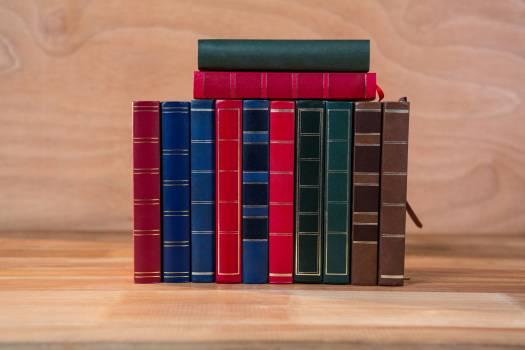 Various books arranged on a table #414516
