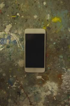 Mobile phone on floor at bicycle workshop #414517