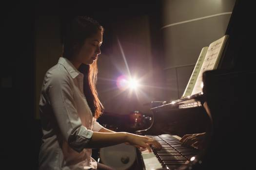 Female student playing piano #414518