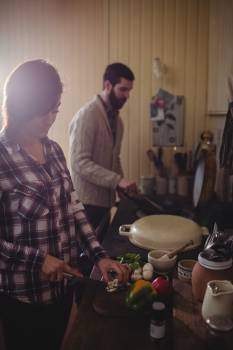 Couple preparing food together in kitchen #414524