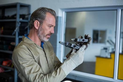 Mechanic checking a car parts #414543