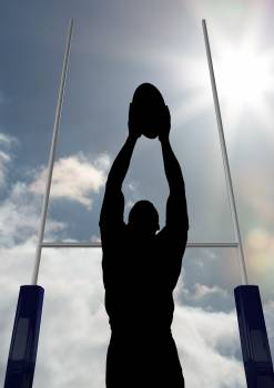 Silhouette athlete playing rugby on a sunny day #414551