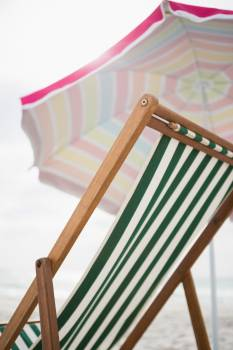 Empty beach chair and parasol #414557
