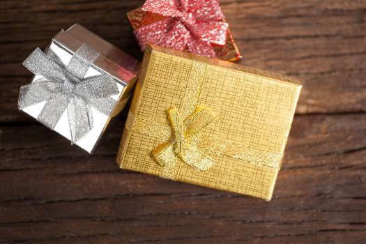 Wrapped gift boxes on wooden table #414569