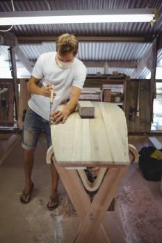 Man making surfboard #414576