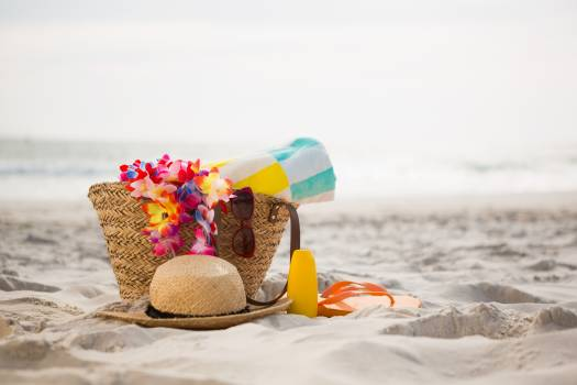 Bag with beach accessories kept on sand #414604