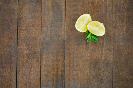 Lemon wedges and mint on wooden board #414613