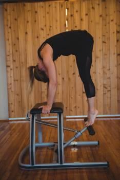 Woman practicing pilates in fitness studio #414620