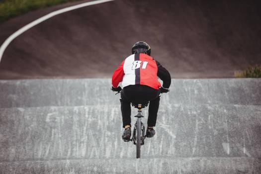Cyclist riding BMX bike in skatepark Free Photo