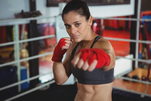 Confident female boxer performing boxing stance #414659
