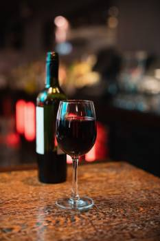 Glass of red wine on bar counter #414688