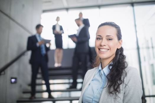 Portrait of a confident businesswoman smiling Free Photo