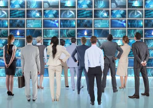 Business executives looking at digital computer interface #414720