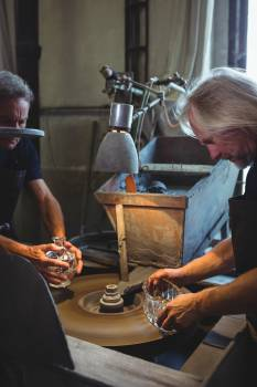 Glassblowers working on a glass #414721