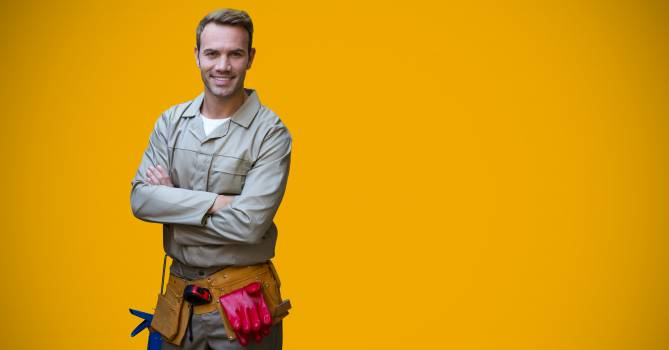 Portrait of handyman standing with arms crossed #414748