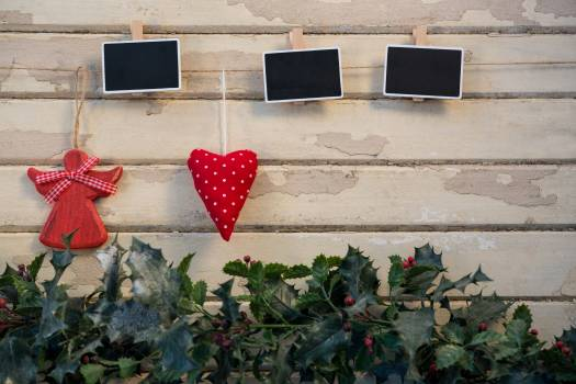 Christmas decorations hanging on wooden wall #414760