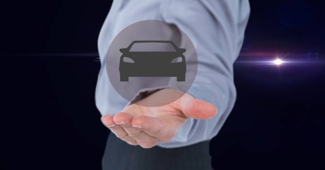 Man pretending to hold car icon against black background #414763