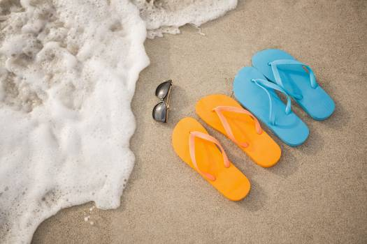 Flip flops, sunglasses and starfish in sand #414777