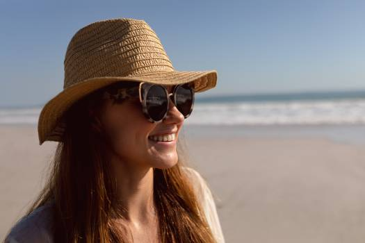 Woman in sunglasses and hat relaxing on the beach #414804
