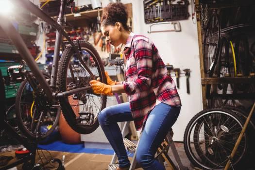 Mechanic repairing a bicycle #414830