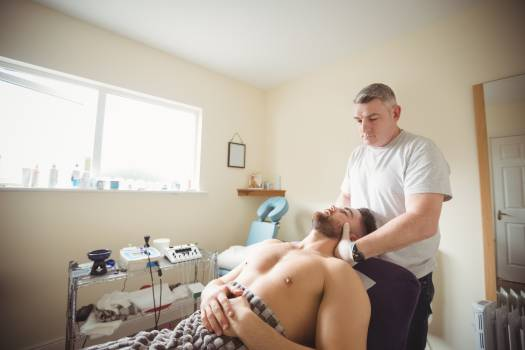 Physiotherapist examining neck of a patient #414863