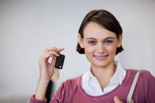 Portrait of smiling customer holding keys #414873