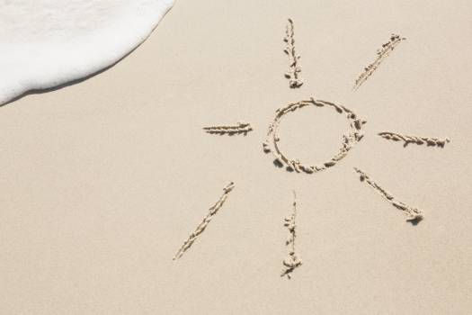 Sun drawn on sand #414891