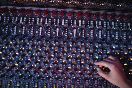 Hands of female audio engineer using sound mixer #414914