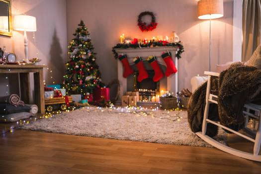 Christmas tree with presents near the fireplace #414924