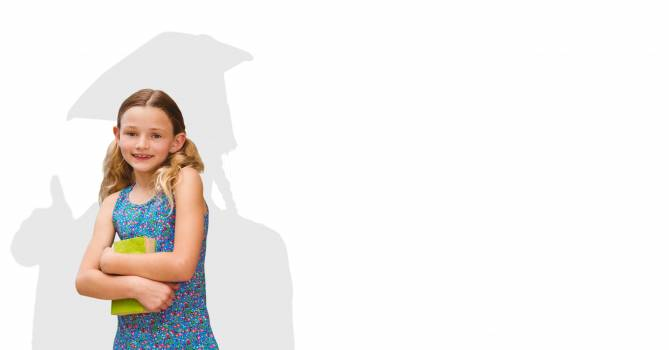 Digitally generated image of smiling girl holding book with shadow of graduate student in background #414934