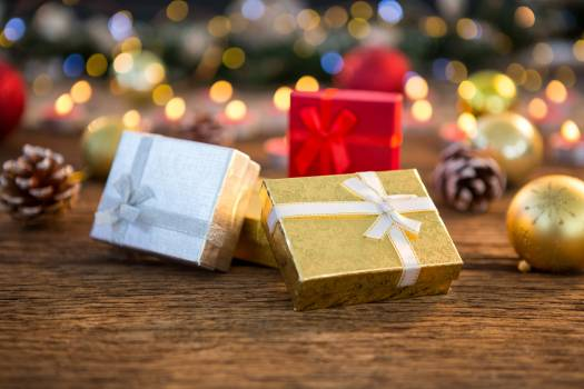 Wrapped gifts on wooden plank #414974