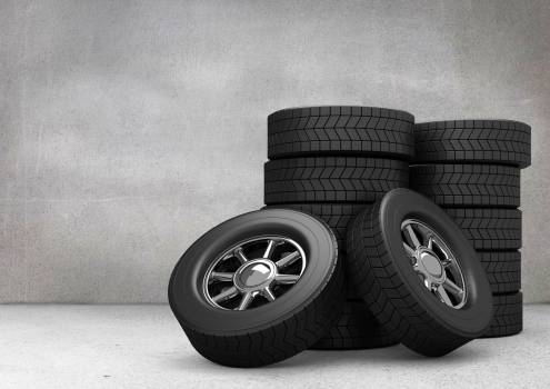Tyres kept on grey background #415030
