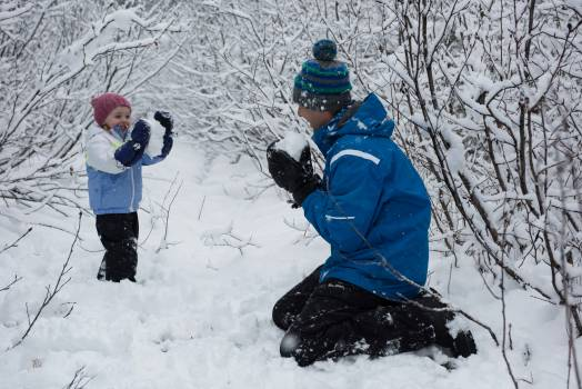 Father and daughter playing with snowballs #415035