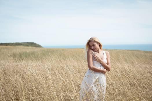 Blonde woman standing in field #415036