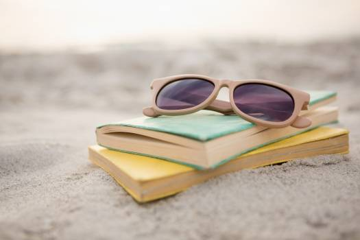 Sunglasses and books on sand  #415038