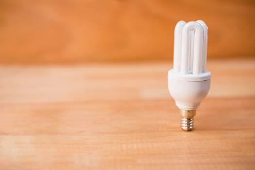 Energy saving bulb on a wooden floor #415040