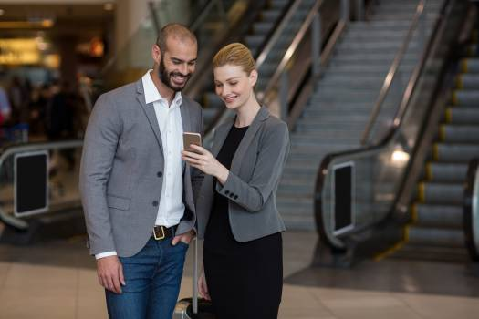 Couple using mobile phone at airport #415042