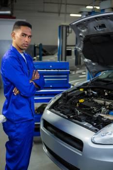 Mechanic standing at repair garage #415044