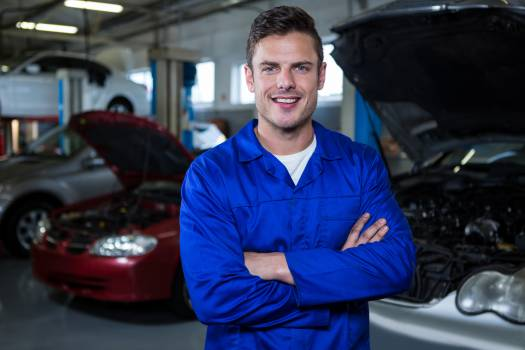 Mechanic standing at repair garage #415056
