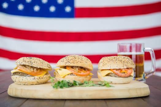 Three hamburger against USA flag background #415059