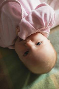 Close-up of cute baby lying on bed in bedroom #415080