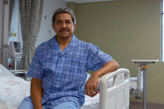 Mature male patient looking at camera in medical ward at hospital #415105