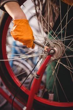 Mechanic repairing a bicycle #415116