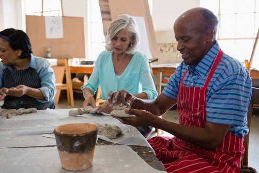 Senior friends making clay products #415121