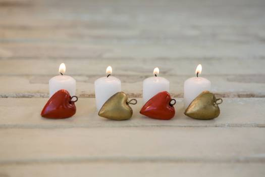 Candles burning on wooden plank #415138