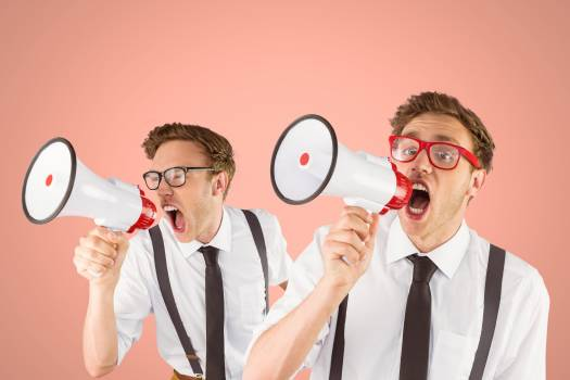 Multiple image of frustrated businessman screaming through megaphone #415151