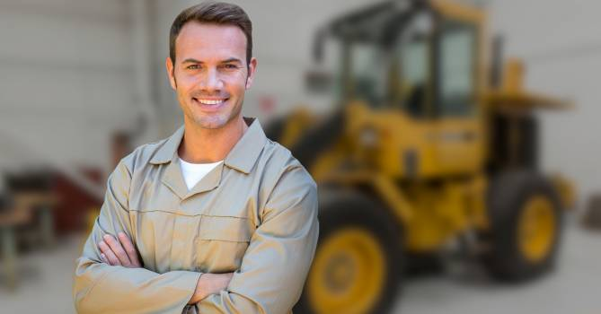 Male worker standing with arms crossed #415173